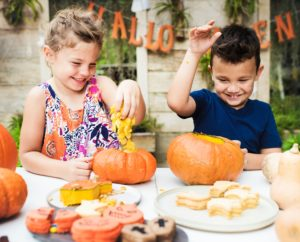 kids carving a pumpkin