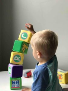 Child playing with soft blocks