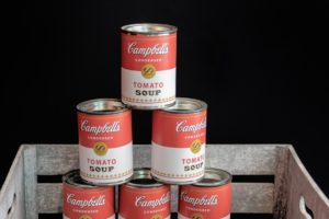 Stacked cans of Campbell's tomato soup